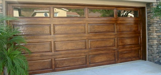 attractive wooden overhead www.bestgarage-door-repair.com
