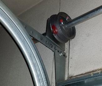 Testing springs extension vs torsion springs best for Changing garage door spring